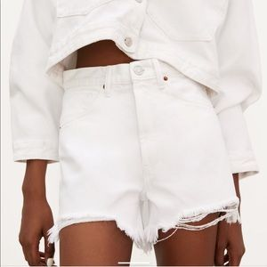 Hi-rise ripped denim shorts
